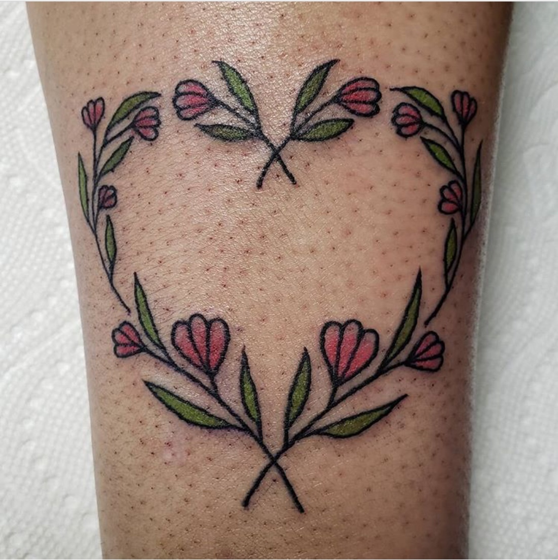 heart tattoo with flowers