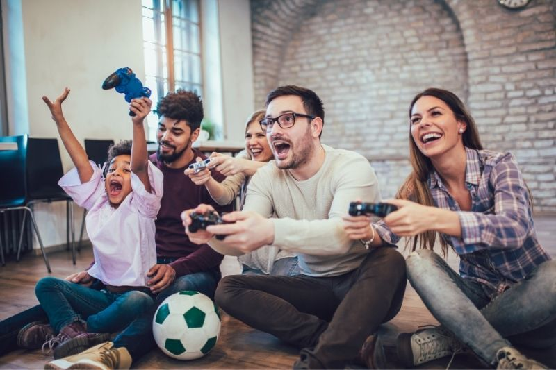two families playing video games