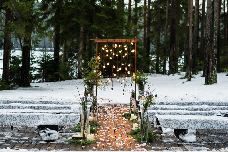 wedding arch decorated with old light bulbs in winter