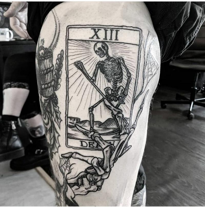 skeleton hands tattoos